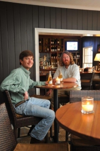 Stewbos co-owners and brothers-in-law Stewart Campbell (left) and Bo Henry enjoy an Albany, Ga.-brewed Miller High Life in the Manor House Pub at Merry Acres Inn.
